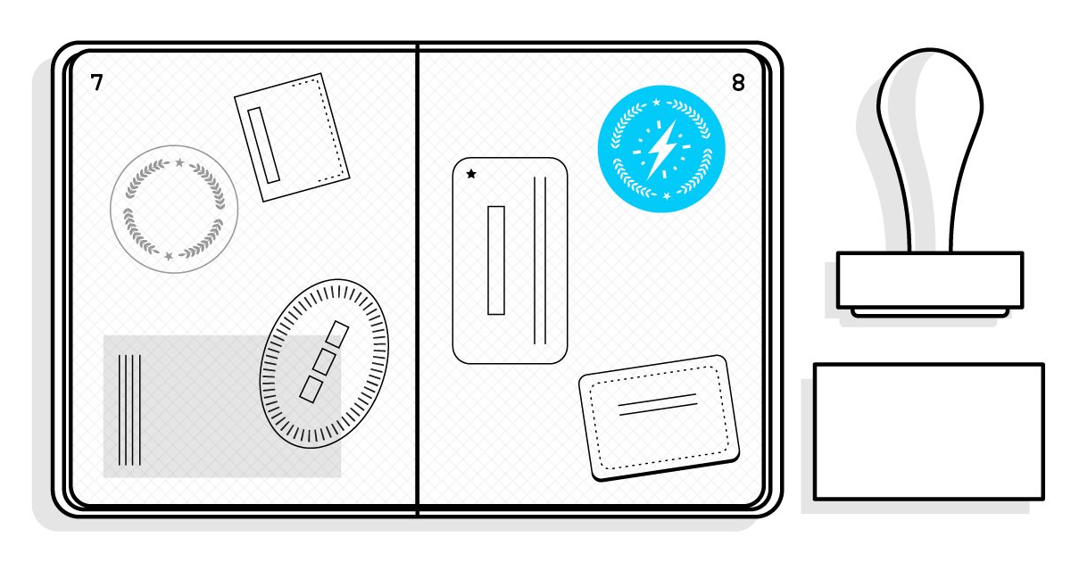 an open passport with plenty of stamps next to a stamp and inkpad