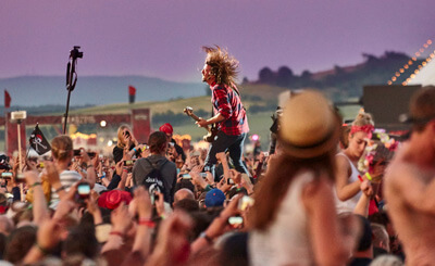 Dave Grohl performing in front of a huge crowd